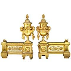 Pair of Louis XVI style gilded bronze andirons