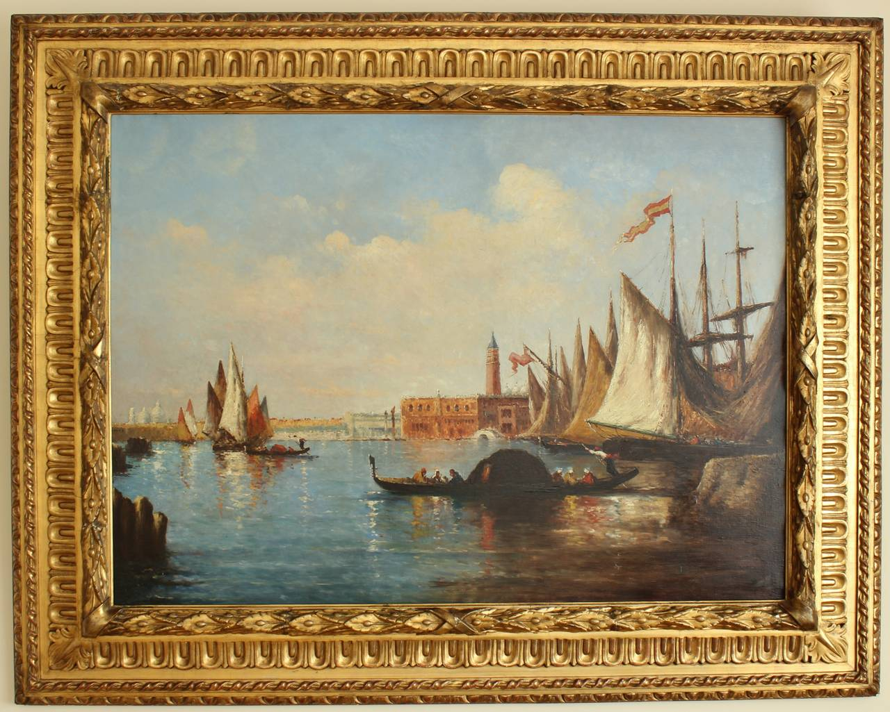 Beautiful composition representing gondolas withPiazza San MarCo in distance. Impressionist painting expressing the luminosity and magic of Venice, its sky and its lagoon. Oil on canvas in its original and striking monumental giltwood frame. Ca.