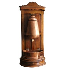 Copper Lavabo on a Walnut support