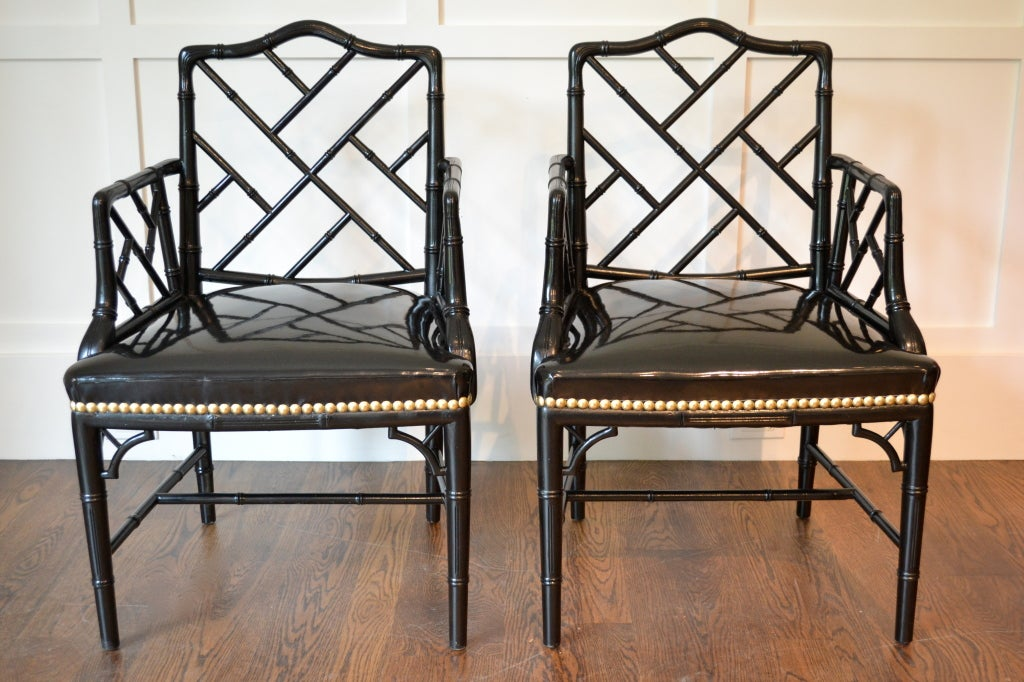 A great pair of faux bamboo chairs, black lacquered with new