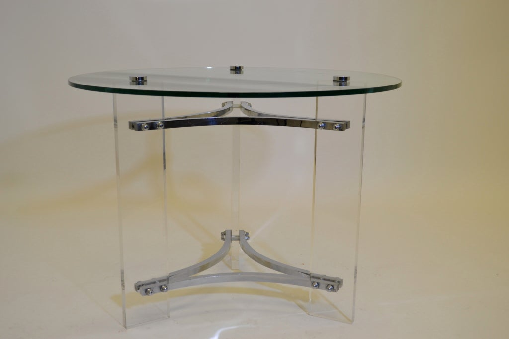 A super quality Lucite and chrome table with glass top by Charles Hollis Jones. Nice heavy chrome, with three chrome knobs holding down glass top. Clear Lucite legs give table a floating quality.