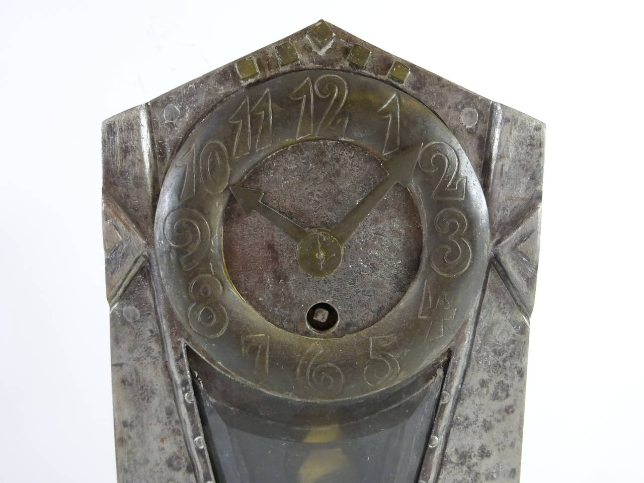 Ludwig Hohlwein iron clock.  Produced by Josef Zimmerman & Co, Munich, circa 1905. Hammered and riveted metal.