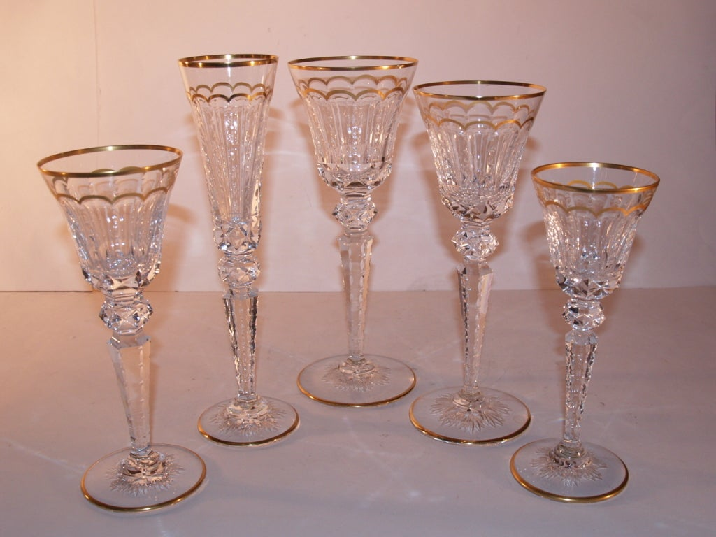 Set of St Louis Cut Crystal Stemware, Gilt urn with scalloped gilt band. 11 Champagne, 8 am water, 12 cont water, 9 burgundy and 19 claret. Total 59 pieces, Original Condition, No chips or cracks