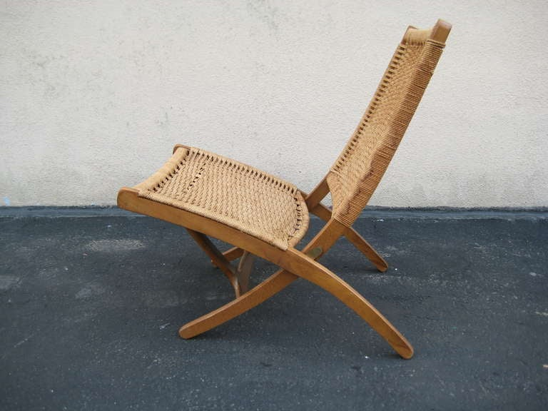 Wood Woven Folding Chair In The Style Of Hans Wegner For Sale