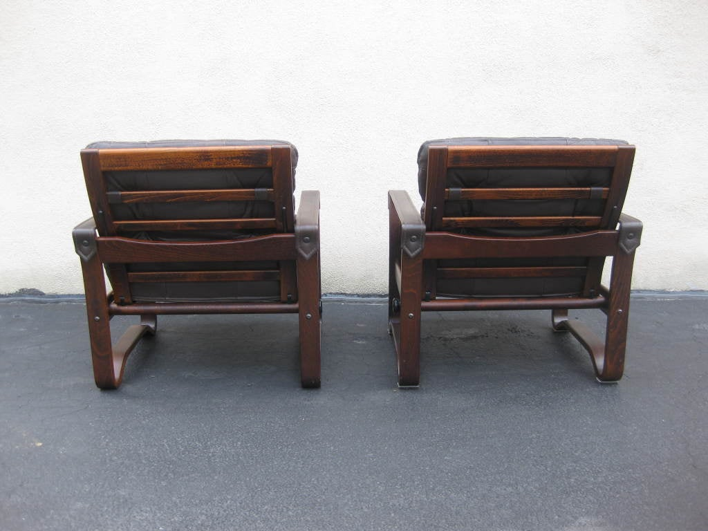 this pair of mid century chocolate leather recliner club chairs is no