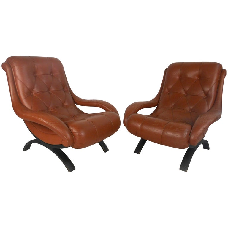 Pair of Midcentury Tufted Leather Lounge Chairs For Sale