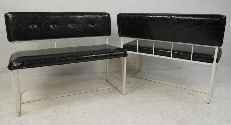 Fun pair of contemporary metal frame settees covered in faux crocodile black vinyl. Please confirm item location (NY or NJ) with dealer.