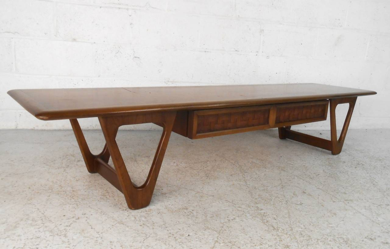 This Sy Walnut Coffee Table From Lane Furniture S Perception Line Features Uniquely Styled Legs And A