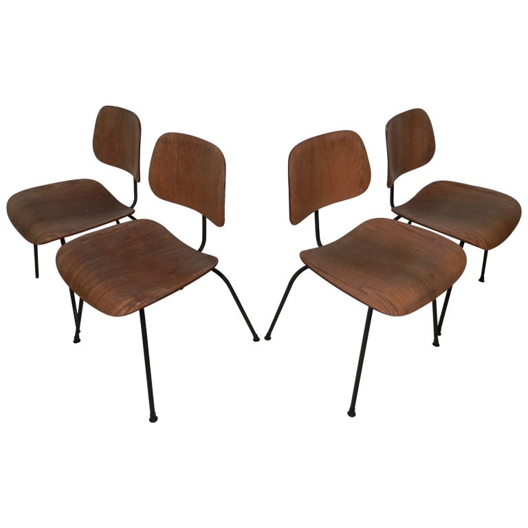 set of four eames dcm bentwood chairs 1