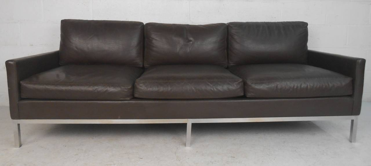 Three seat deep brown leather sofa on chrome-plated base in the style of Florence Knoll. Please confirm item location (NY or NJ) with dealer.