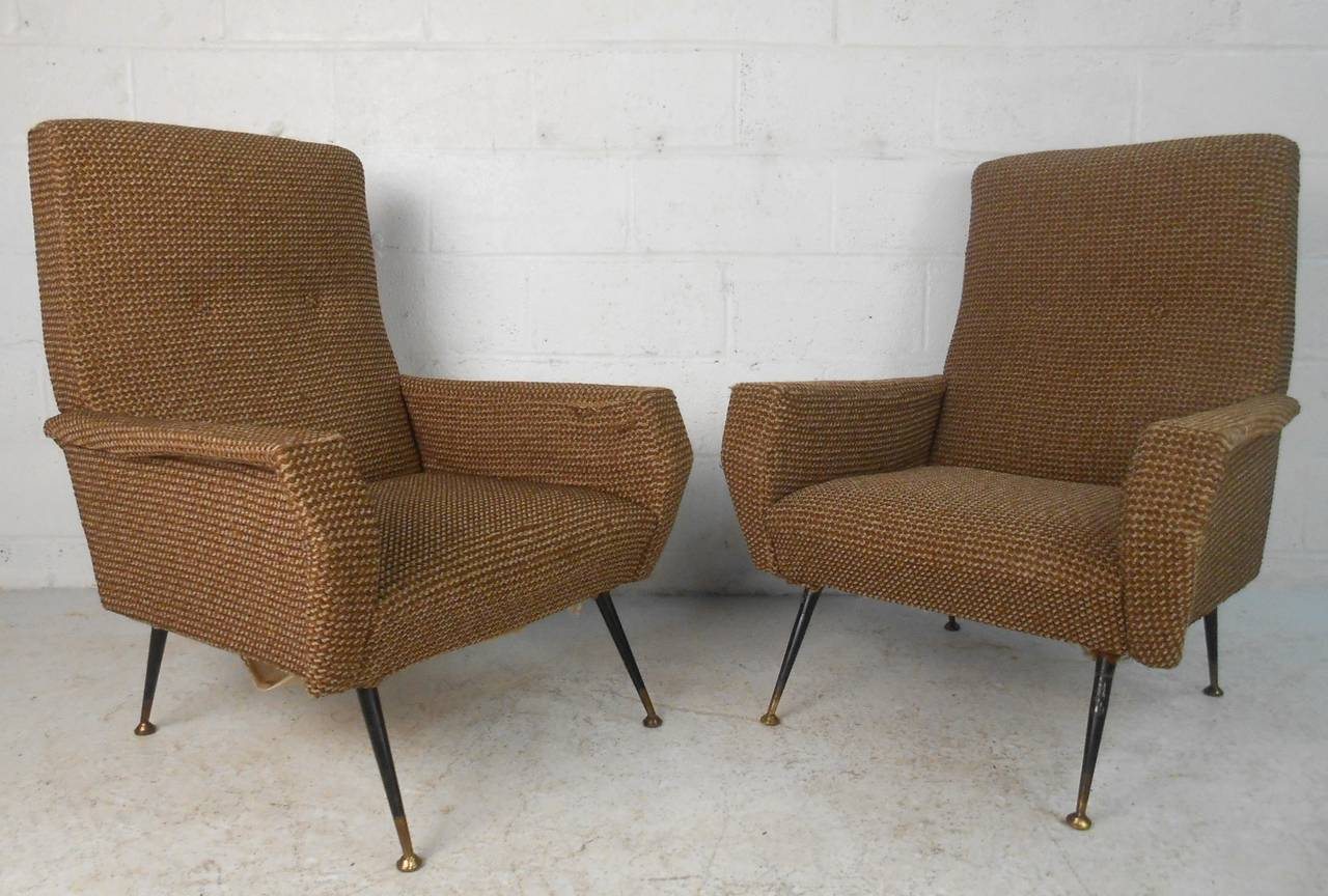 This matching pair of arm chairs feature stylish frames with unique frames set on tapered metal legs. Wonderful seating for any Mid-Century space, please confirm item location (NY or NJ).
