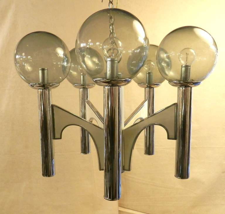 Elegant and modern five light chandelier with smoked glass globes. Angular chrome body shape. Lovely for any dinning room or entry way.  (Please confirm item location - NY or NJ - with dealer)
