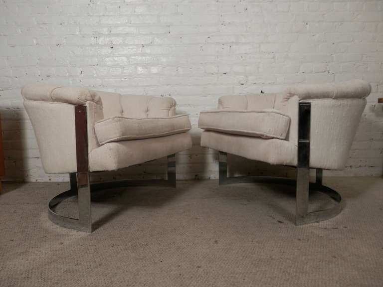 Pair of super mod chrome frame club chairs with a tufted fabric seat. The polished chrome ring frame holds up the seat giving a floating appearance. Very comfortable and elegant.  (Please confirm item location NY or NJ with dealer).