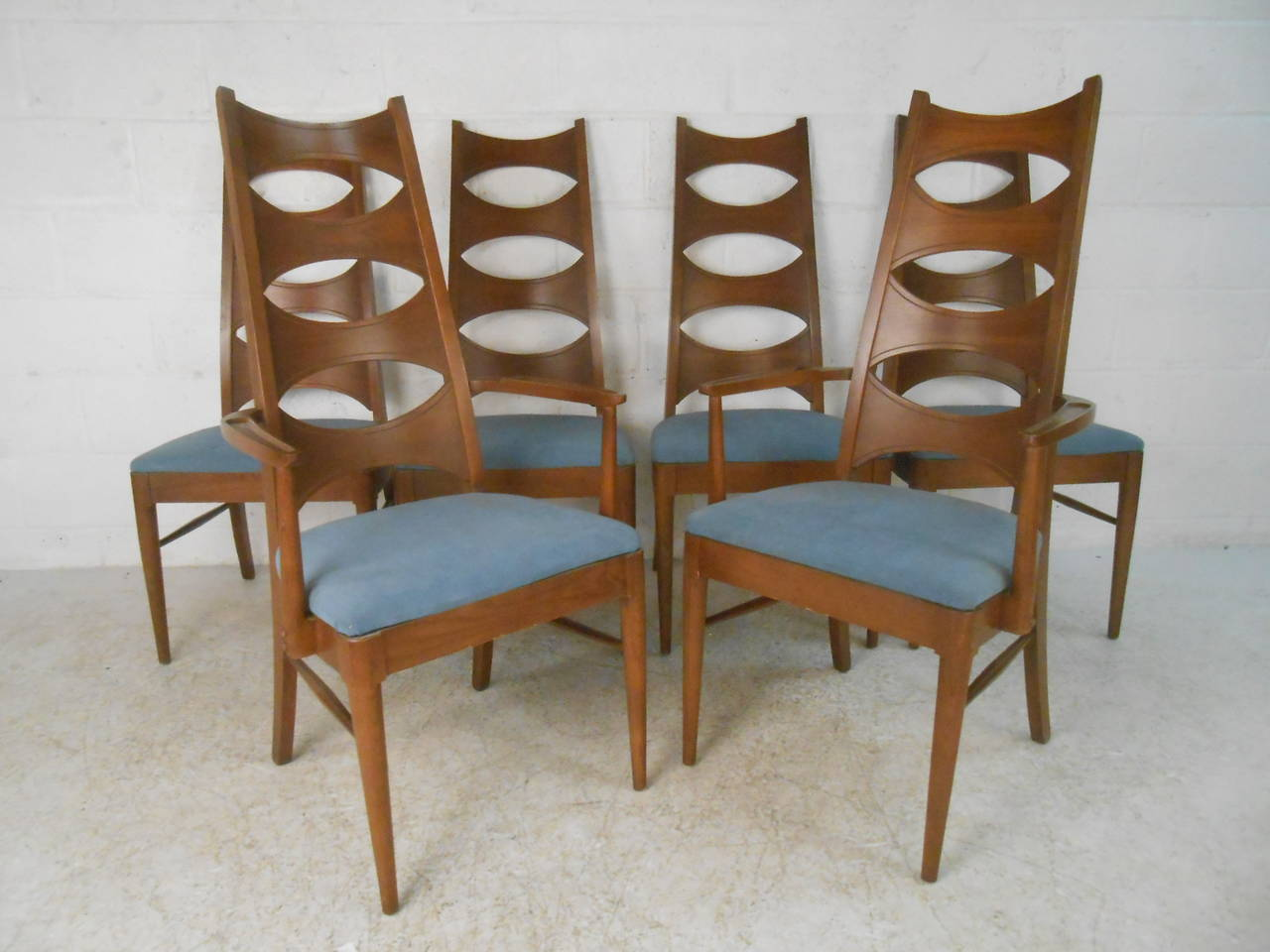 Set of mid century modern cat eye dining chairs by kent