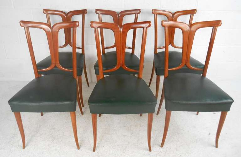 Set of six vintage Italian dining chairs with green vinyl seats and elegant sculpted back. Unusual tapered legs that curve slightly out. Very similar style and age to Osvaldo Borsani made Italian chairs. 