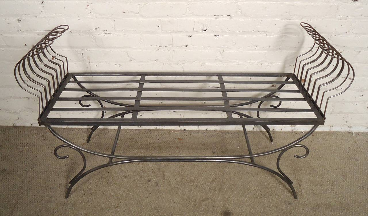 Very unique metal bench with curved sides, and scrolling trim. Stripped down for a striking bare metal finish. 