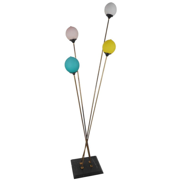 Stylish and striking, four-light floor lamp with frosted glass shades, marble base and brass-plated arms. Suggestive of balloons on strings, this is an ideal fixture for a children's room. Please confirm item location (NY or NJ) with dealer.
