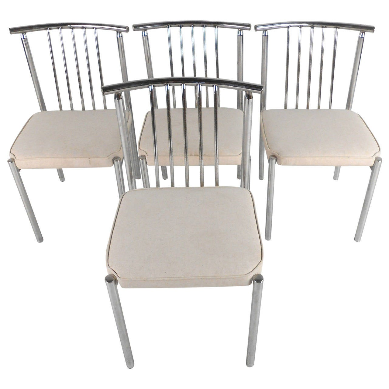 Set of unique mid century modern designer chrome dining for Modern chrome dining chairs