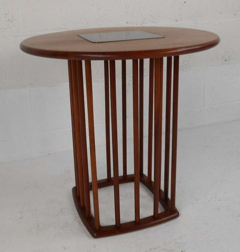 Unique mid-century walnut side table. interesting design with spindle base and a laminate insert at the center of the tabletop. Unusual piece sure to please in any modern interior. Please confirm item location (NY or NJ) with dealer.