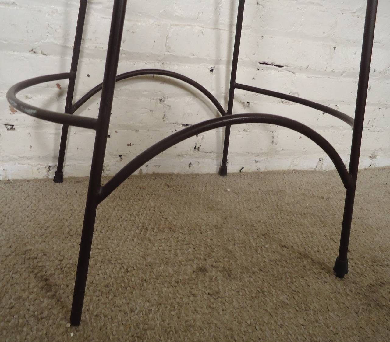 Four Mid Century Iron And Wicker Stools In The Style Of