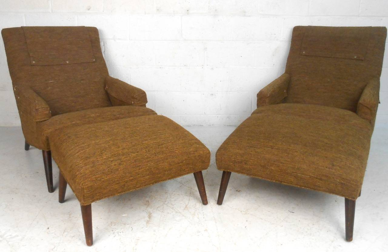 pair of unique mid-century modern lounge chairs with ottomans for
