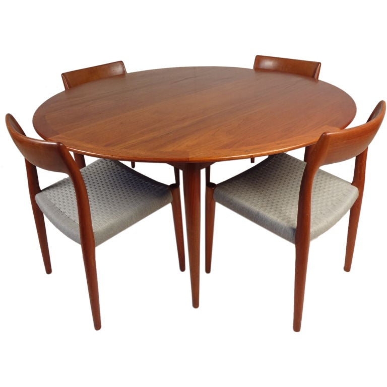 Teak dining table and set of six chairs by niels o moller for Six chair dining table set