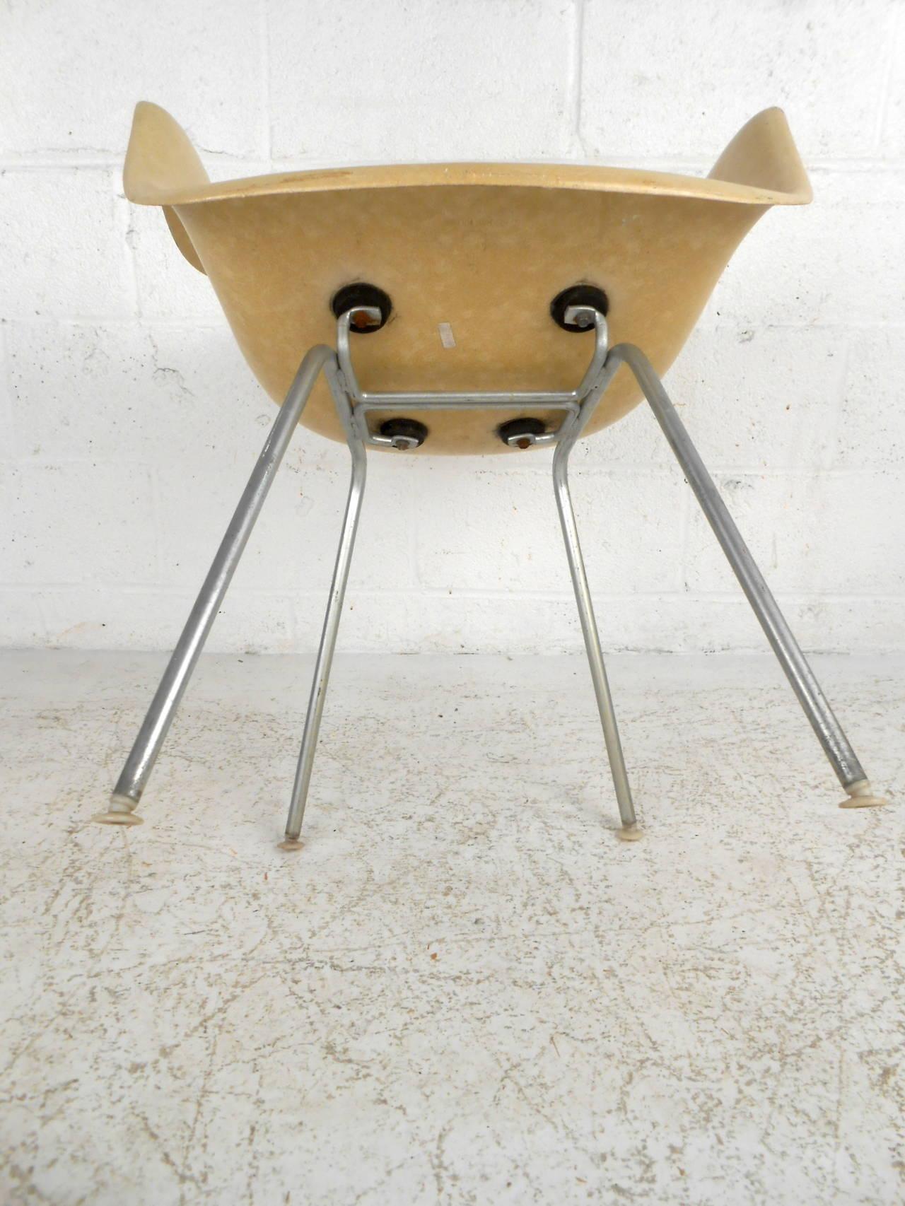 Mid century modern fiberglass shell chair by eames for herman miller