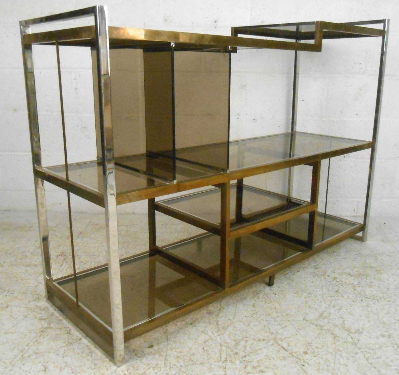 This Unique Low Bookshelf Features Wonderfully Designed Shelves Set In Sturdy Chrome And Brass Frame