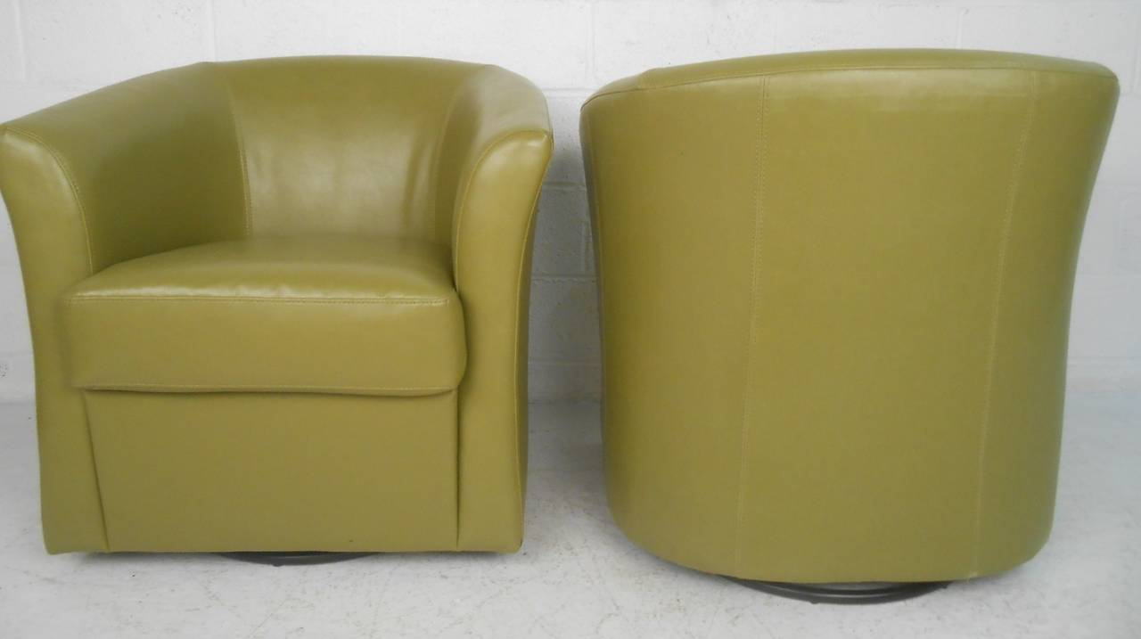 Mid century modern pair of mid century style green vinyl swivel club chairs for sale