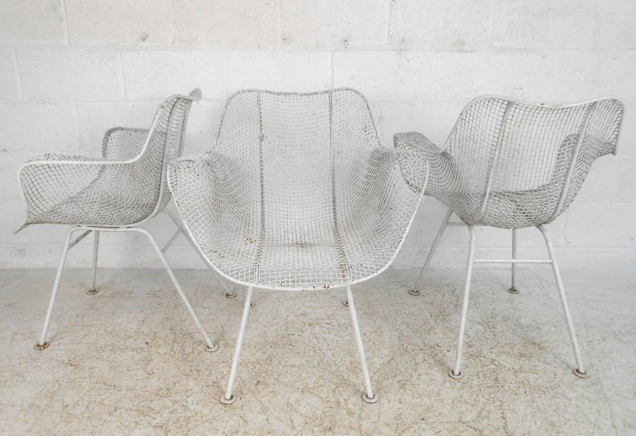This classic four-piece set of mid-century chairs makes a wonderful addition to modern outdoor/indoor settings, featuring the creative style of Russell Woodard. Please confirm item location (NY or NJ).