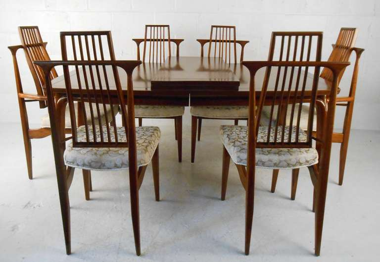 Mid-Century Modern American walnut dining set featuring six sculptural chairs and table with two leaves. Please confirm item location (NY or NJ) with dealer.