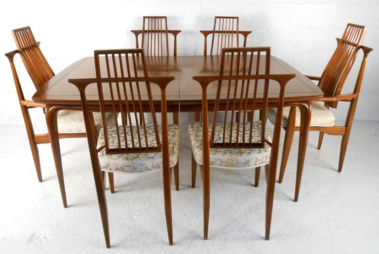 this unique mid century walnut dining room set is no longer available