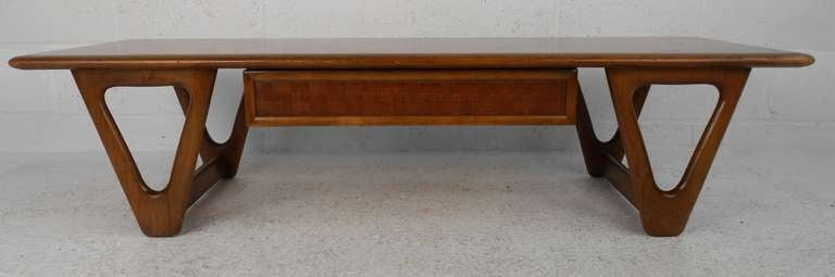 Vintage walnut coffee table with lattice-front drawer by Lane features stylish mid-century modern design by Warren Church. Please confirm item location (NY or NJ) with dealer.