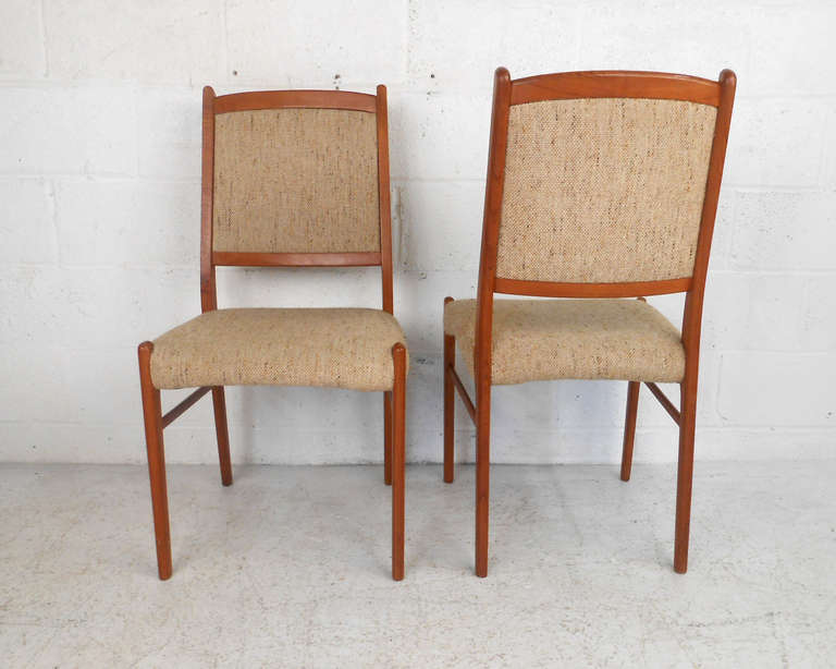 Set of unique danish teak dining chairs at 1stdibs for Unique dining set furniture