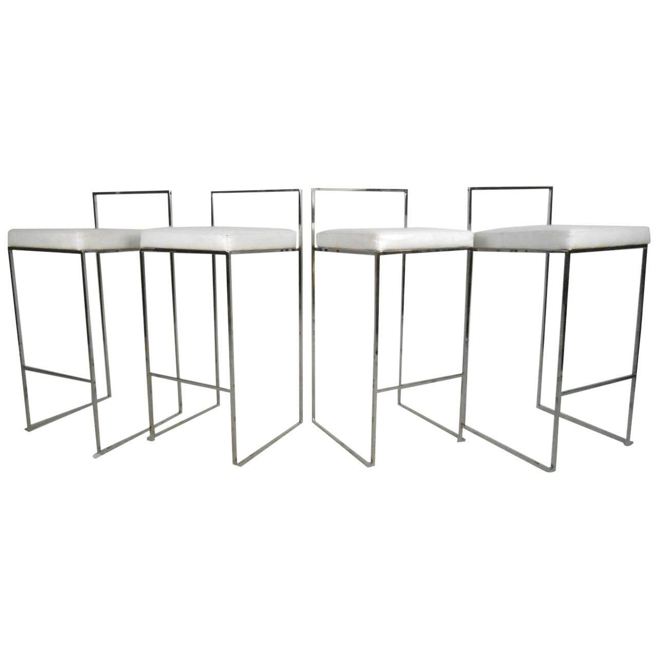 Set of mid century modern chrome bar stools attributed to milo