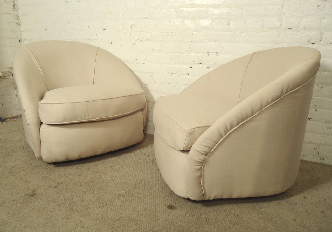 Milo Baughman style barrel back chairs on a swivel base. Thick, comfortable cushioning with attractive lines.  (Please confirm item location - NY or NJ - with dealer)
