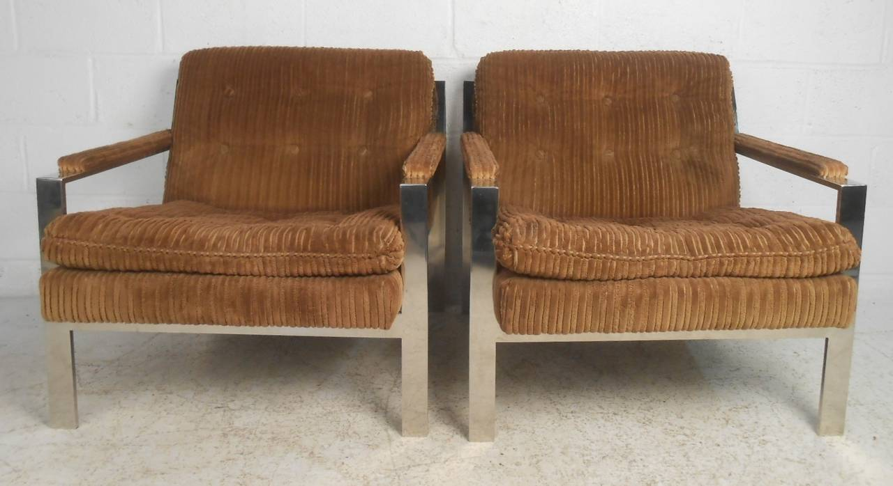 Pair of Cy Mann lounge chairs in the style of Milo Baughman feature sturdy chrome frames and tufted corduroy style upholstery. Comfortable and unique pair of Mid-Century Modern club chairs perfect for home, office, or set design. Please confirm item