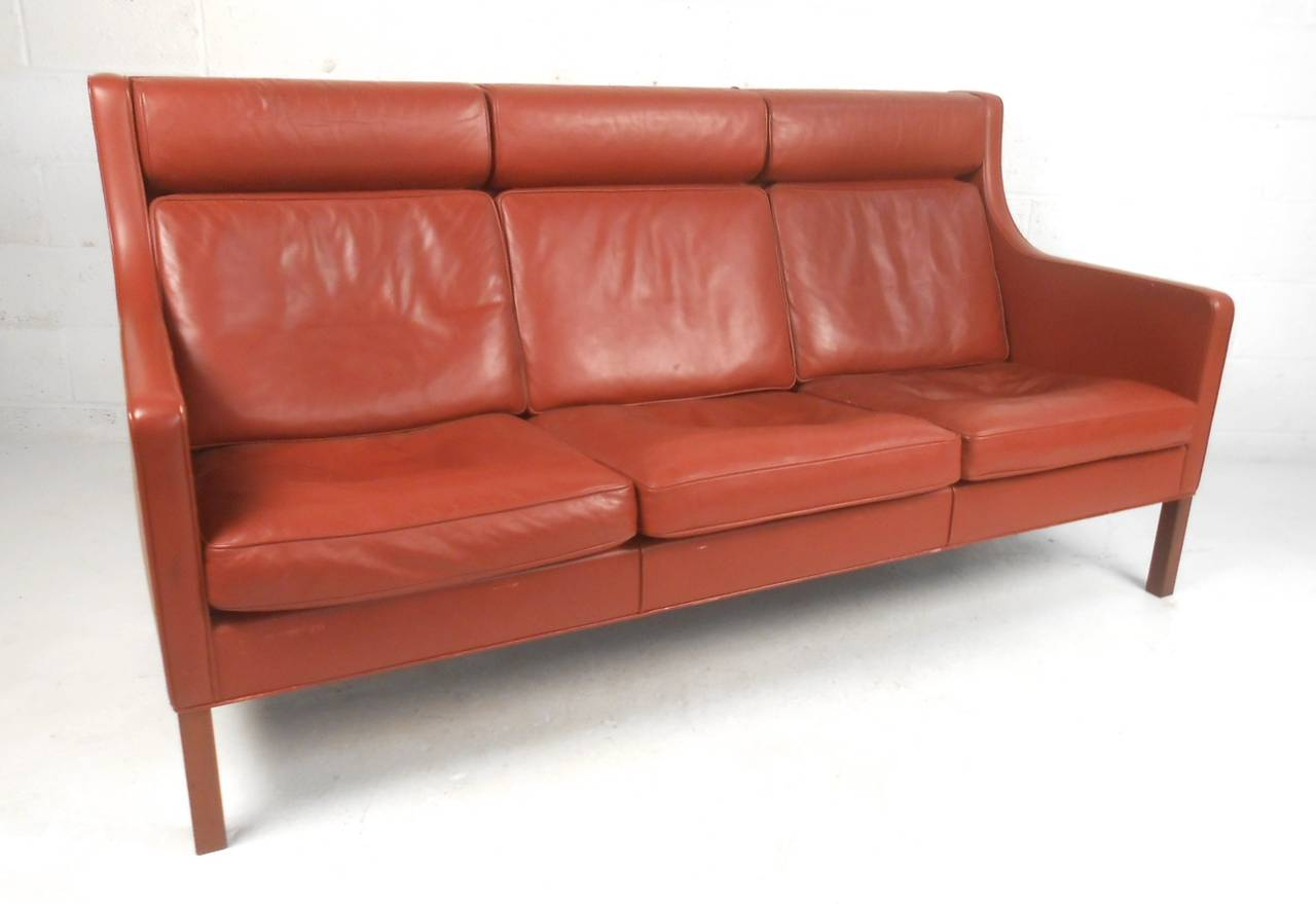 This beautiful vintage leather sofa designed by Børge Mogensen provides the perfect mix of Mid-Century style and timeless comfort. Unique high back seat with added headrests adds to this Classic design. Please confirm item location (NY or NJ).