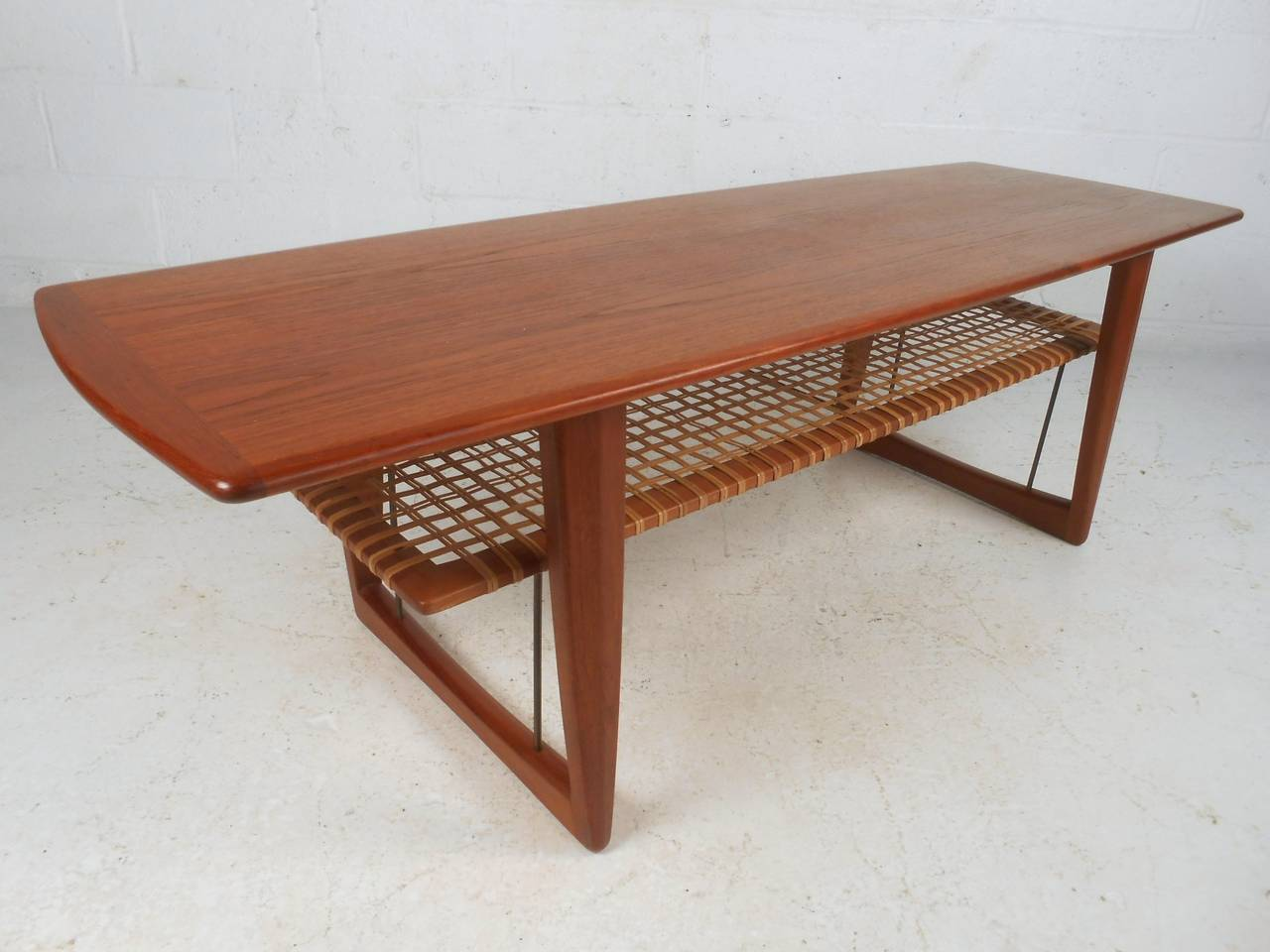 This Beautiful Teak Coffee Table Features Unique Sled Legs Cane Shelf And A