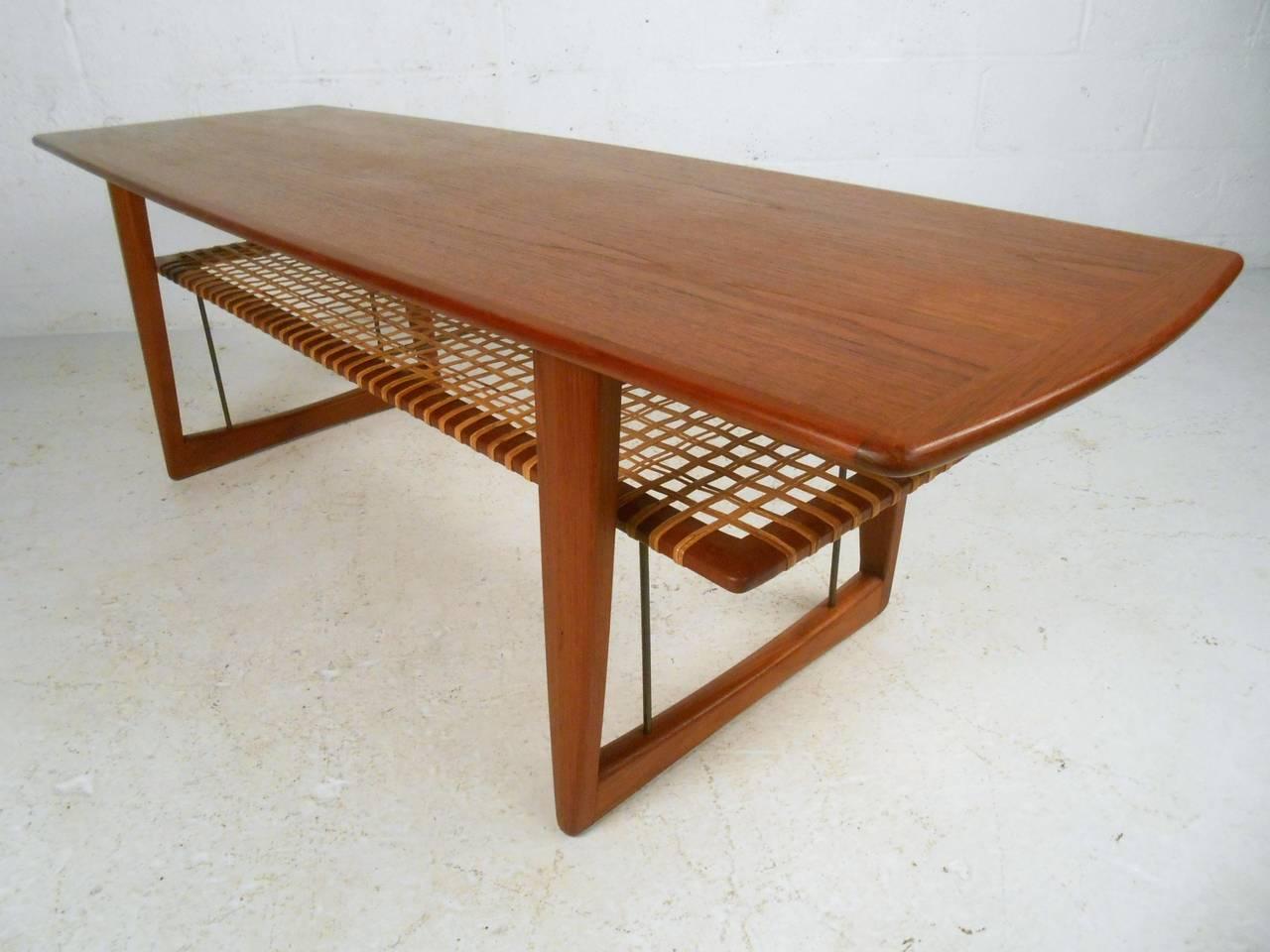 Mid century danish teak cane shelf coffee table in the for Scandinavian coffee table