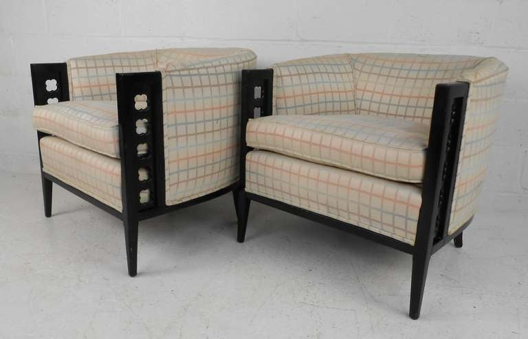Pair of upholstered side chairs with black lacquer frames and comfortable barrel back design. Classic style and timeless comfort make these a wonderful addition to home or business. Please confirm item location (NY or NJ) with dealer.