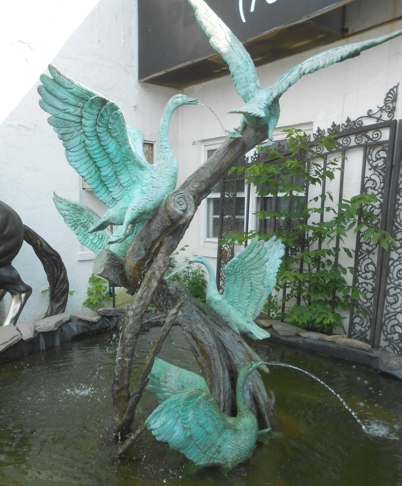 This lovely fountain is crafted using treated bronze to accentuate the greenish patina of the birds and contrast to the dark tree base.  Perfect piece for garden or pond. Please confirm item location (NY or NJ) with dealer.