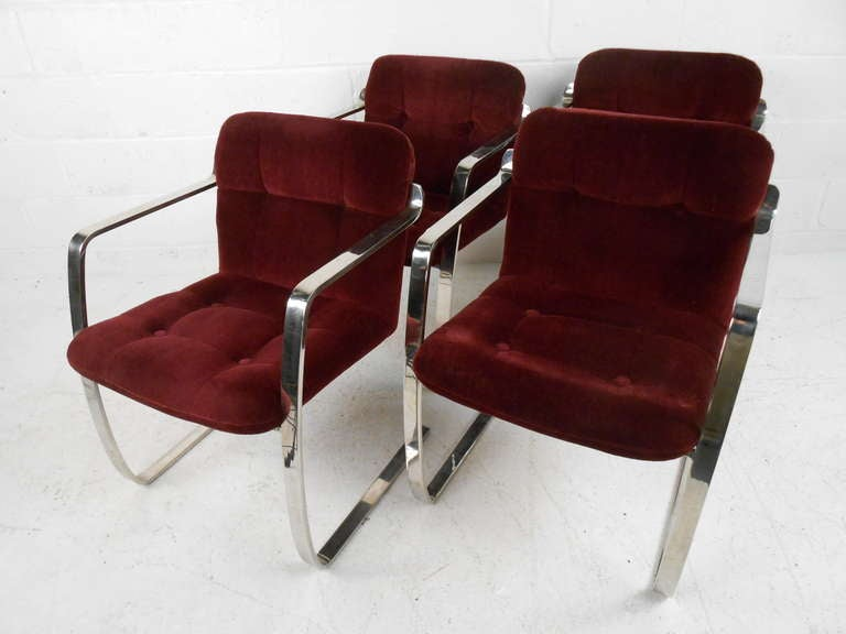 Set of four dining chairs make a stylish Mid-Century Modern addition to any dining room. Heavy flat bar chrome frames, Brno style design and cantilever bases add to the vintage charm. Please confirm item location (NY or NJ) with dealer.