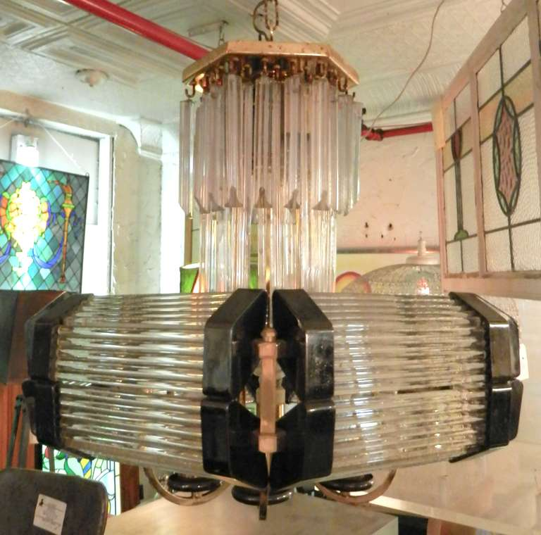 Dazzling vintage modern hanging light with all glass rod and hanging prisms. Six standard and three candelabra sockets. Features a nice combination of brass and nickel finishes along with horizontal glass rods and hanging cut prisms.  (Please