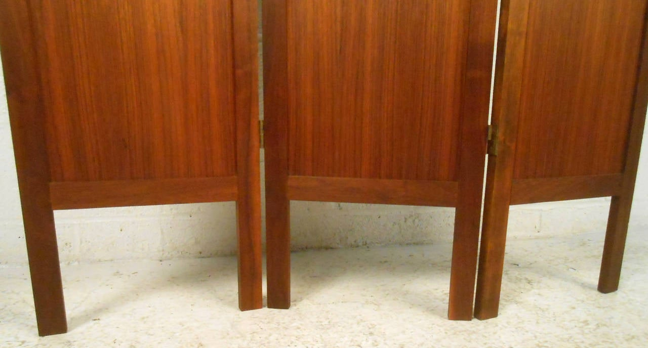Vintage-modern 1960s American made room divider, beautifully sculpted with rich wood grain and brass hardware.