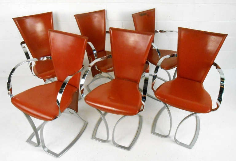 This beautiful set of six Italian Modern dining chairs feature uniquely shaped metal frames with high back leather seats. The sculptural qualities of this mid-century dining set make it an impressive and memorable addition to any interior. Please