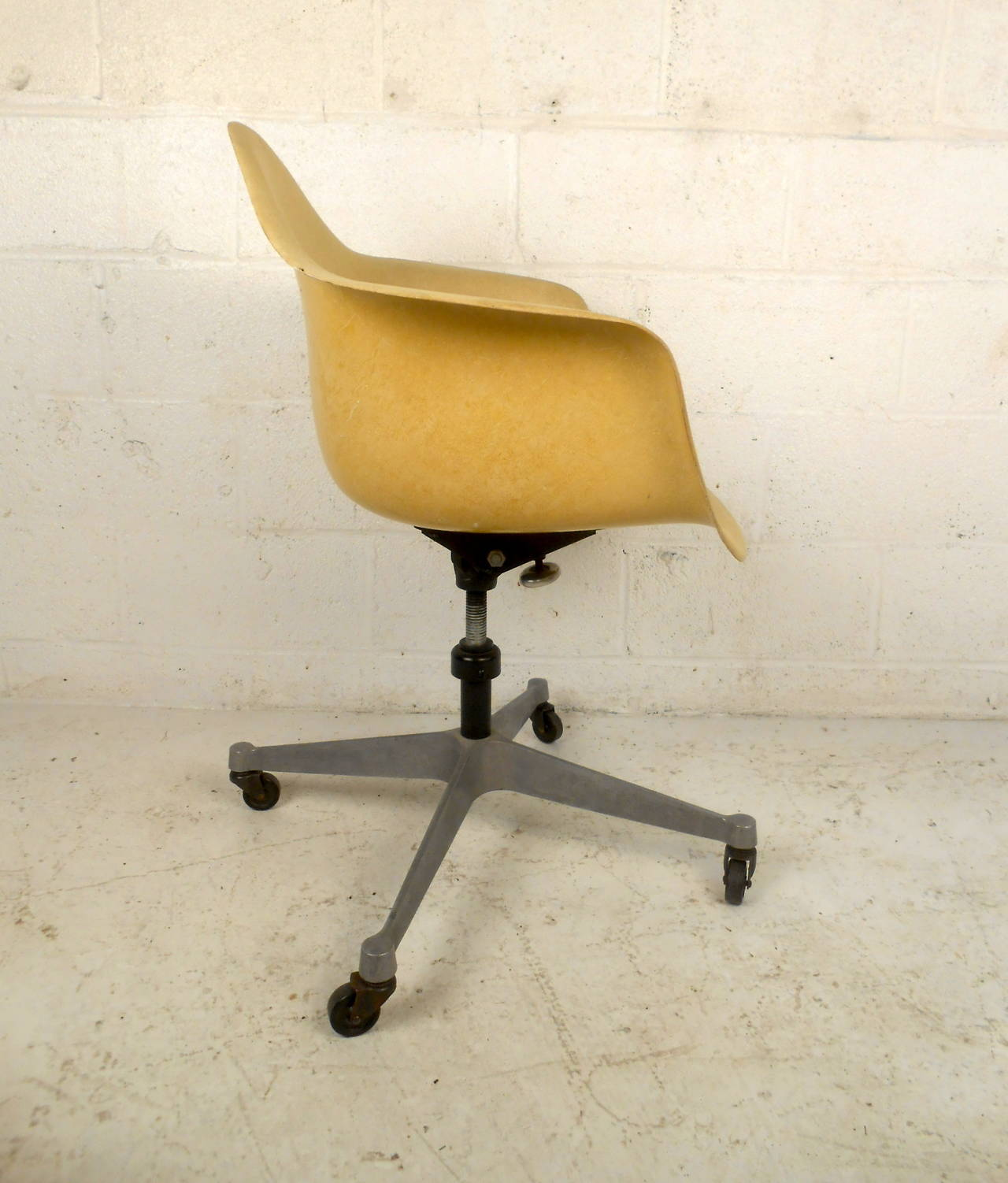 This Charles Eames Shell Chair For Herman Miller Features A Molded Fibergl Seat Adjule Height
