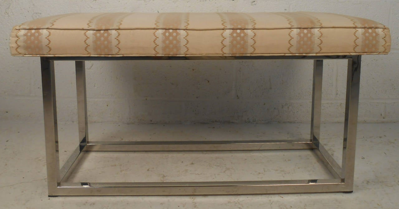 Vintage 1960s modernist bench features sturdy polished chrome frame with upholstered top.