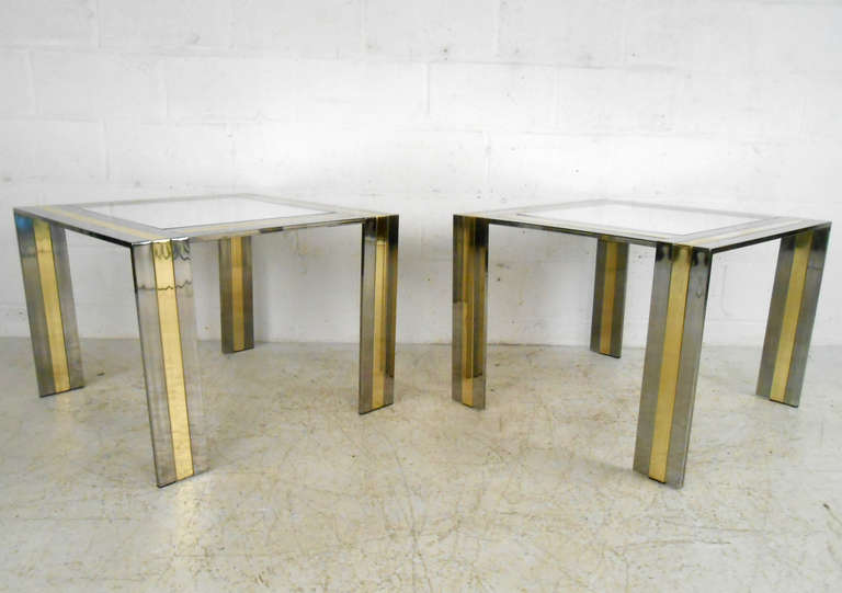This pair of mirrored midcentury end tables features Paul Evans style design, combining sturdy chrome bases with glass tops. Perfect modernist addition to any home or business. Please confirm item locations (NY or NJ).