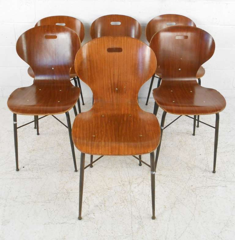 Stylish set of six molded plywood shell chairs with metal bases. Please confirm item location (NY or NJ) with dealer.